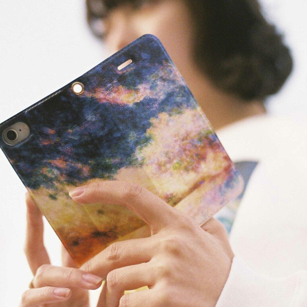 青い夜明けを描いた、手帳型スマホケース