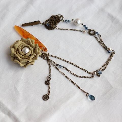 薔薇と歯車の帯飾り