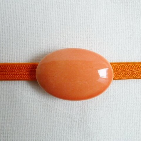オレンジ釉薬の帯留め(三分紐用)